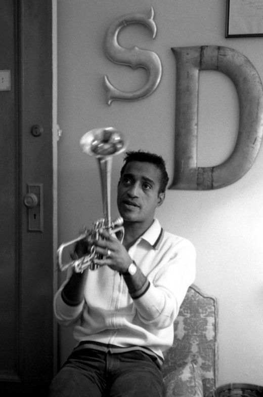 Though he often joked about his race, Sammy Davis Jr. (here fiddling with a trumpet in 1964) was a serious, high-profile civil rights activist, and his refusal to play segregated venues helped lead to the integration of Miami nightclubs and Vegas casinos. ~My Mom had  huge crush on him.