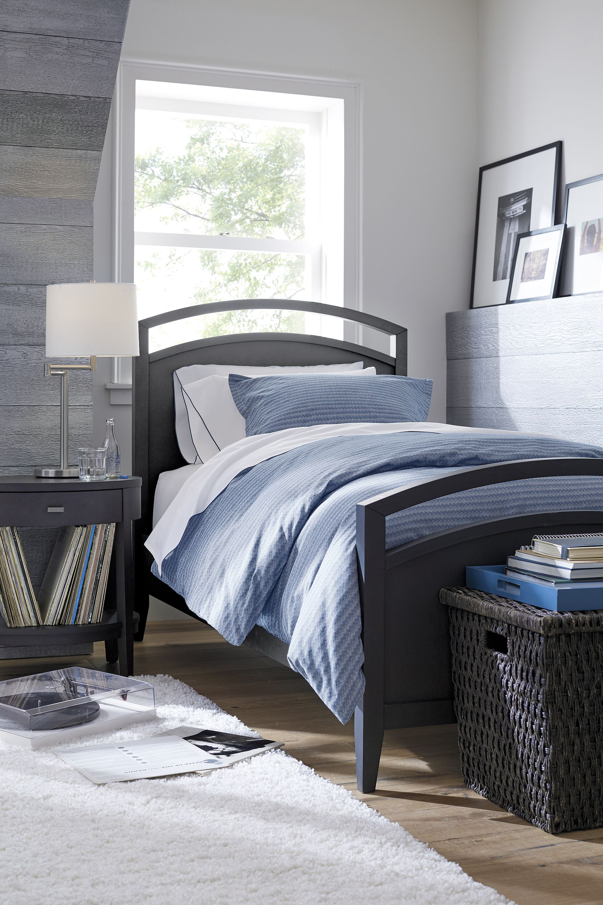 Sharply dressed in deep charcoal the streamlined curves of the arch twin beds headboard and footboard combine with the subtle taper of the legs for a