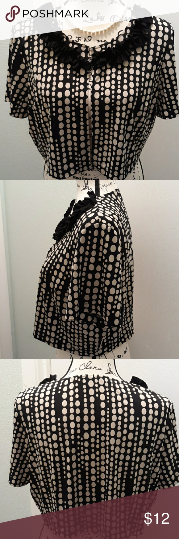 Danny and Nicole dress jacket size 14 Danny and Nicole dress jacket size 14 Cute black and dark cream polka dot jacket Perfect over a black dress Came with a dress (lost in the move) Accented with a ruffle neckline Features hook and clasp front closure 95% polyester 5% spandex B: 40-42  W: 40 L: 15  #0137 Danny & Nicole Jackets & Coats Blazers