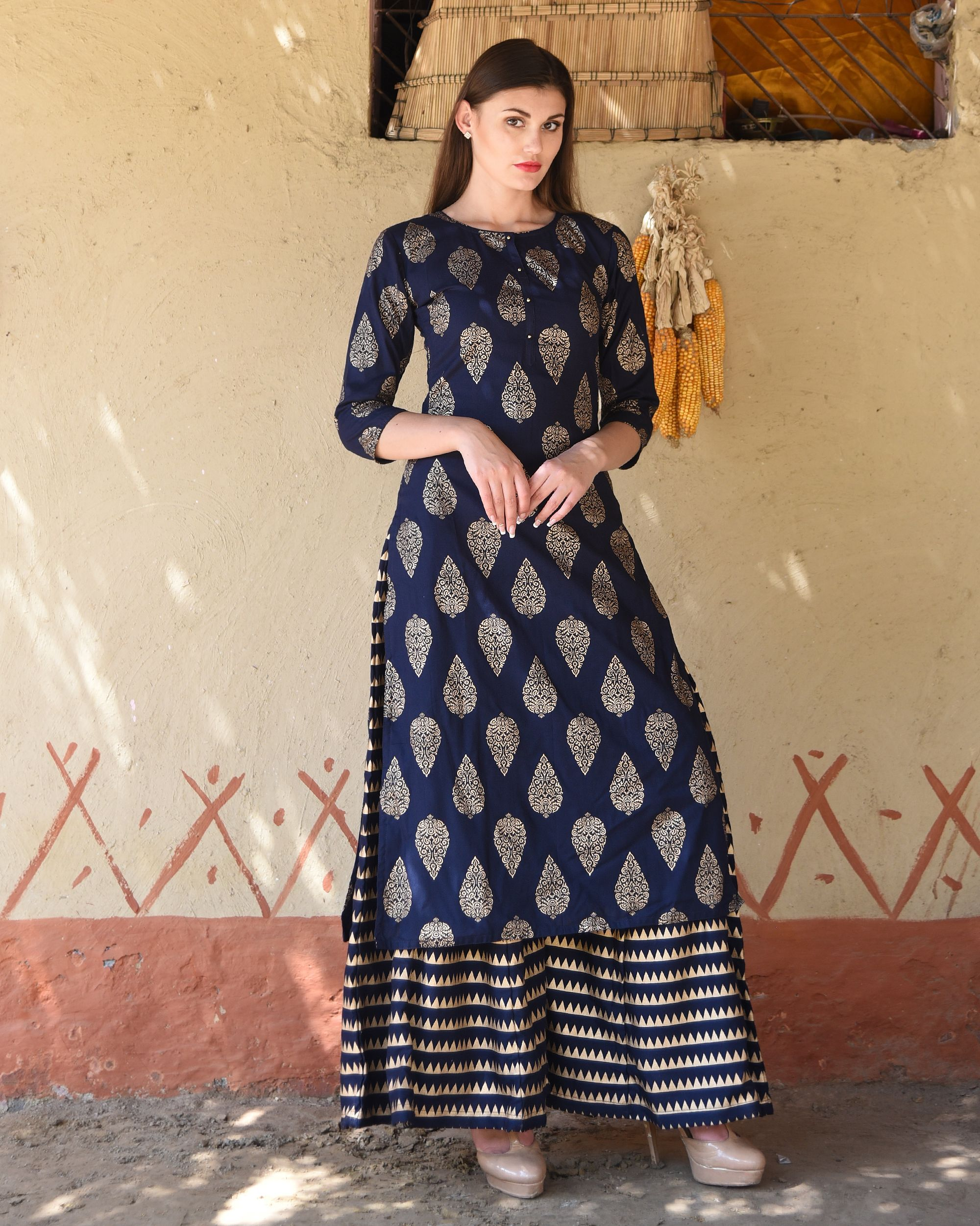 22fdaba2ab Featuring eye-catching block prints all over the kurta, this navy blue kurta  set with the matching striped palazzos exudes unmatched panache with style  and ...