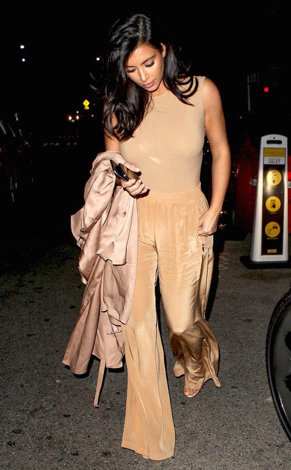 4e560f134b9 Kim Kardashian was seen wearing a sleeveless nude tone bodysuit and  wide-legged pants as she left the Gjelina restaurant. Hot! Or Hmm..