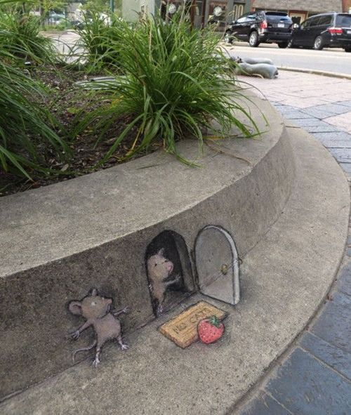 David Zinn is a street artist from Ann Arbor, Michigan, who turns cracks and dusty corners into surreal fantasy scenes. His imagination spreading out on to thestreets of hiscity, it's asif chara...