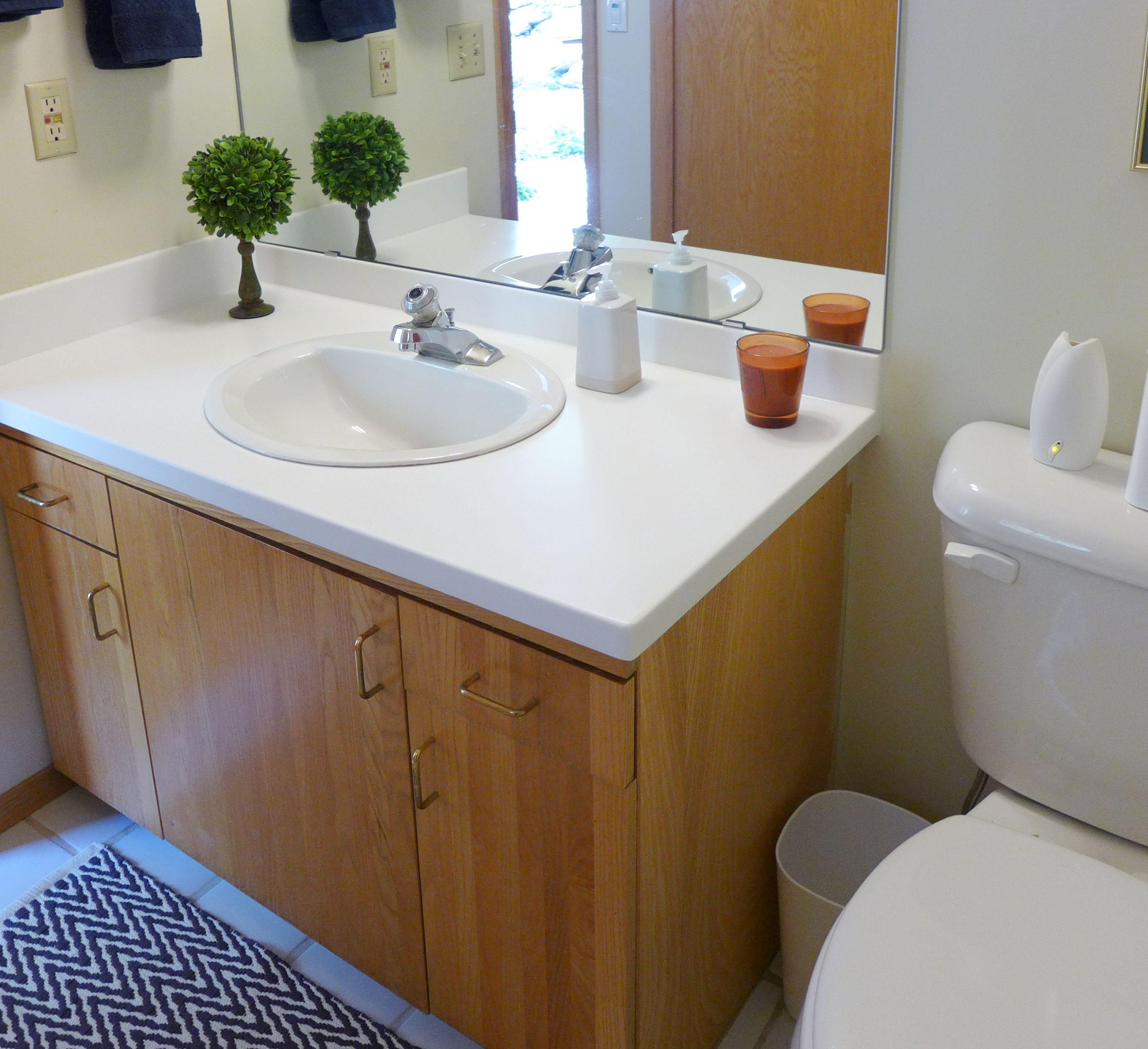 Gray Bathrooms With Accent Color: Glacier White Corian - Accent Interiors