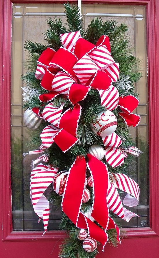 christmas door swag with candy cane striped ribbon