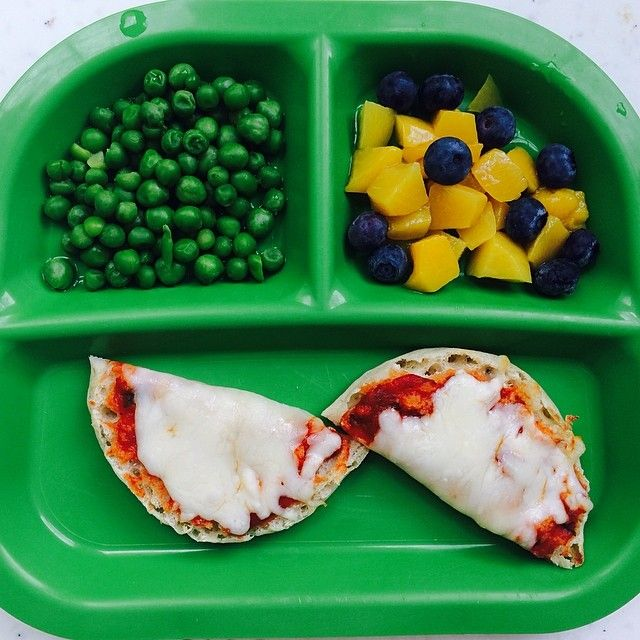 English muffin pizza (to make: top English muffin with pasta sauce and shredded cheese. Bake at 450 degrees for about 5 minutes - until cheese has melted.) - Peas - Peaches and blueberries