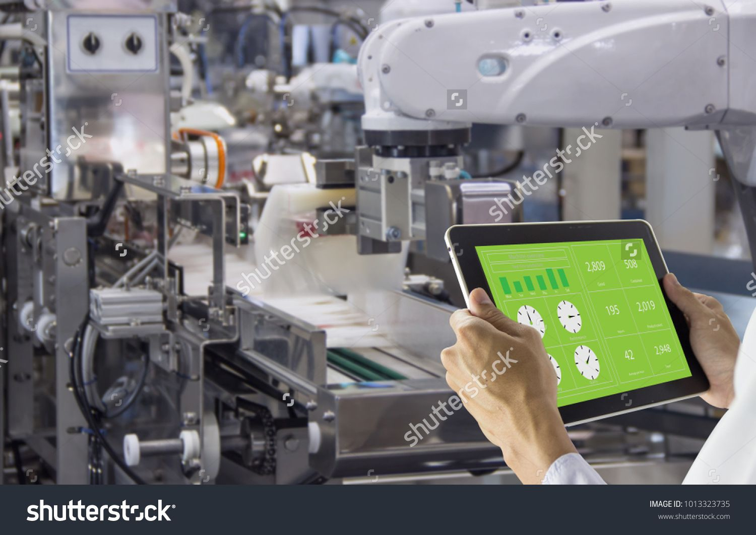 Industry 4 0 Robot Concept Engineers Use Laptop Computers For