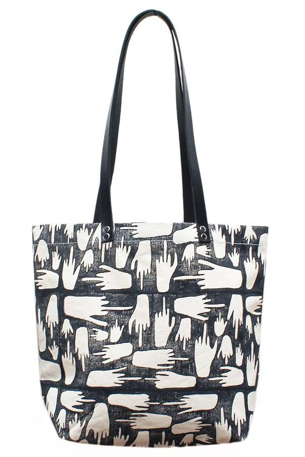 ec47b2235483 This sturdy natural canvas tote bag is adorned with a sassy hand-printed  block design. Dimensions  Measures x x Details  Canvas.