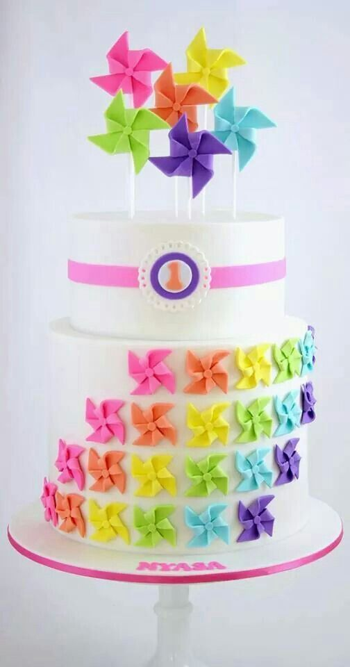 Colorful pinwheel 1st birthday cake A piece of cake Pinterest