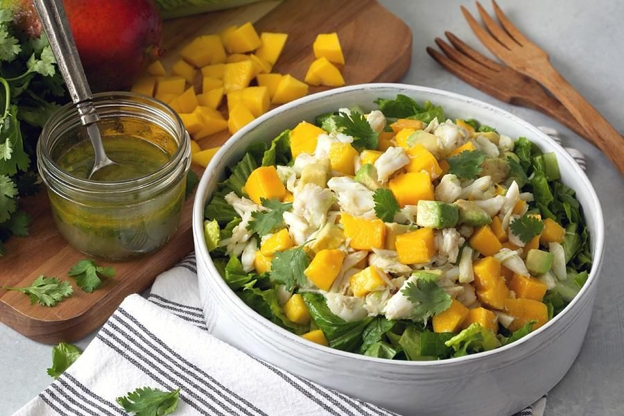 Fresh crab, ripe mango, and creamy avocado combine in a light, luscious salad from Ayesha Curry, host of Food Network's Ayesha's Home Kitchen. A bright lemon...