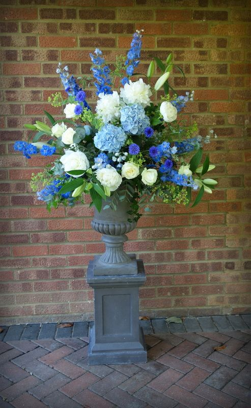Beautiful Delphiniums, Hydrangea and Cornflowers create a lovely blue summer wedding. Add blue white china fishbowl