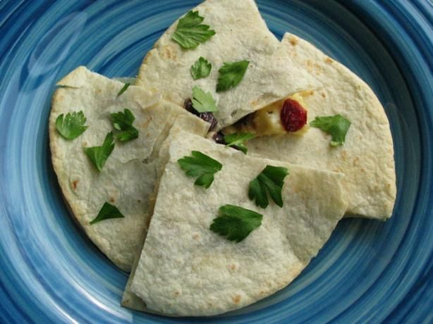 Craisins® sprinkled over brie combine to make a magical new quesadilla flavor.