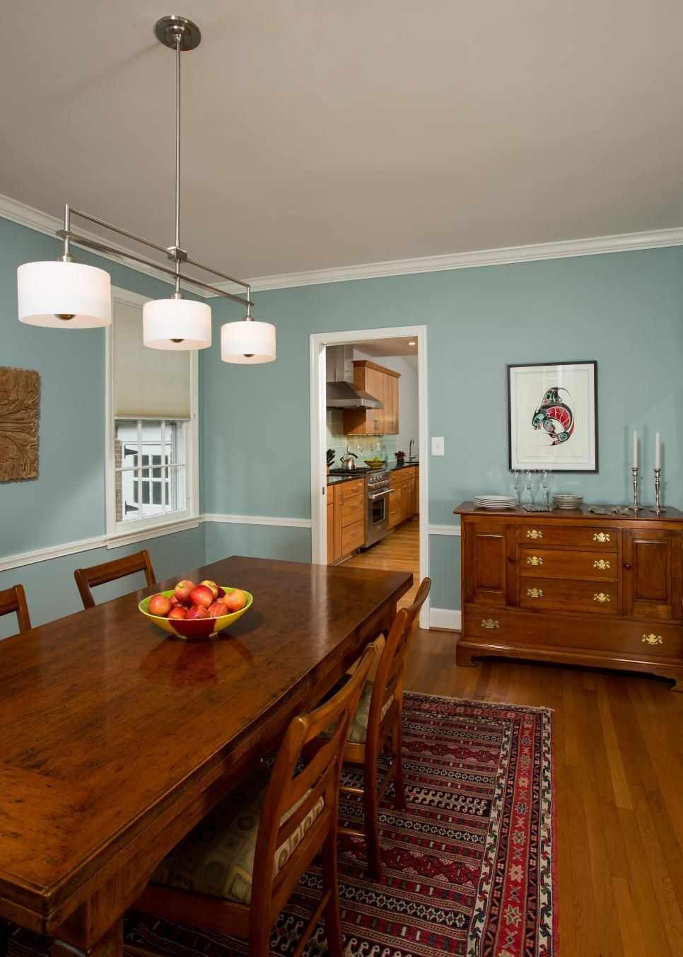 This Dining Room Uses Gray Blue Walls And A Delicate Light