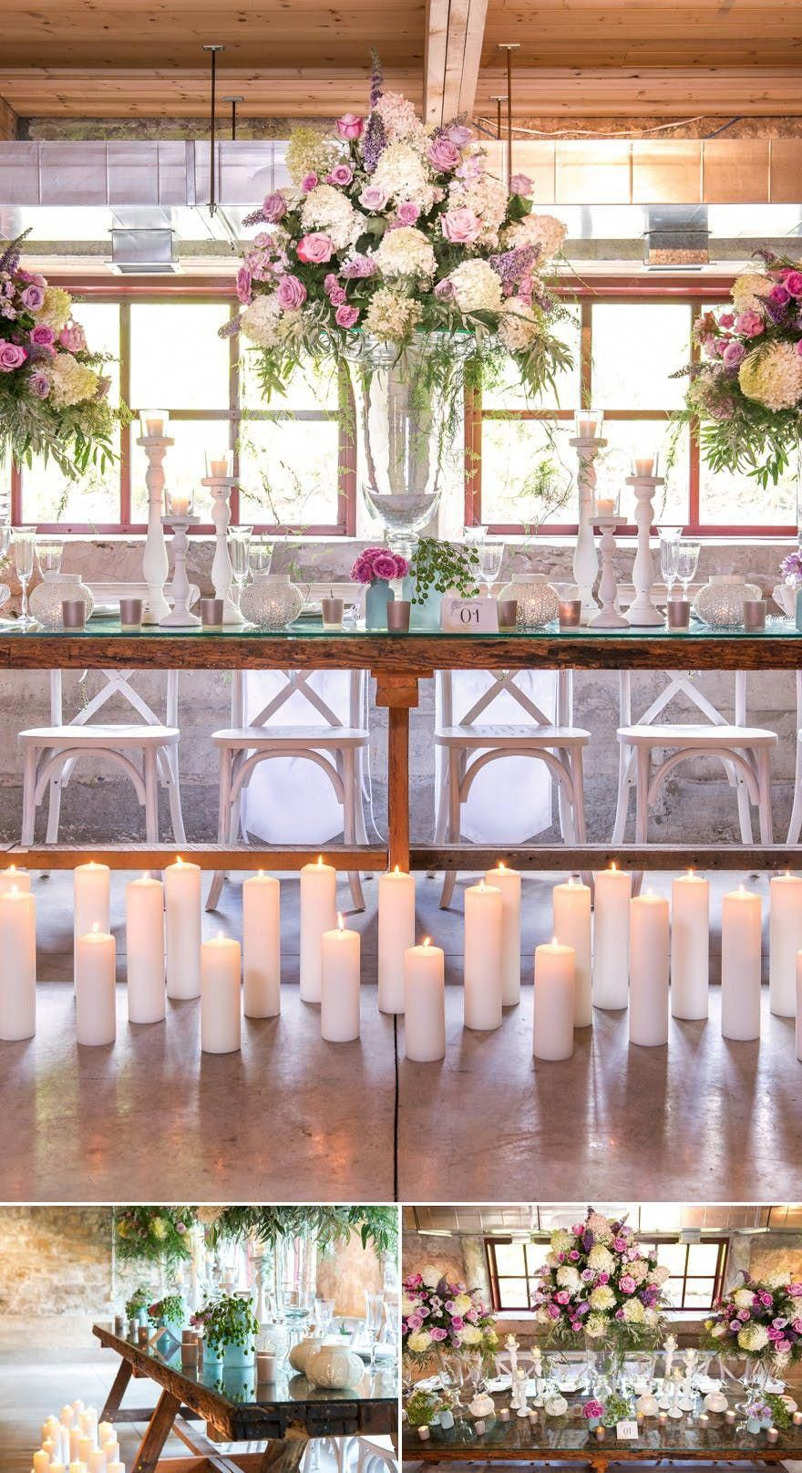 Bohemian wedding decor with glass vases and big floral