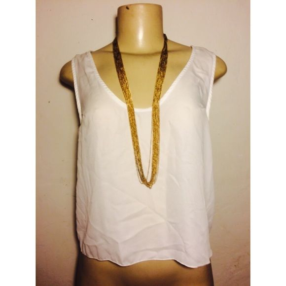 Heart back shirt Really loose and comfy. Really cute in the back Michele Tops Blouses