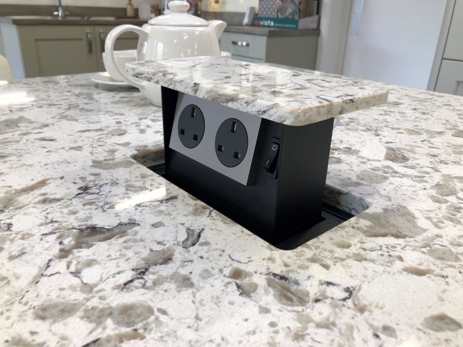 A Set Of Handy Hidden Plug Sockets In The Counter Top Of This