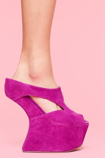 How in the world would you walk in these. Very strange.