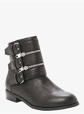 "These black faux leather moto booties feature an almond toe with two silver tone zipper accents between three decorative buckles and have a tonal side zipper entry.<ul><li> 8"" tall</li><li>1"" heel</li><li>Man-made materials</li><li>Imported</li></ul>"