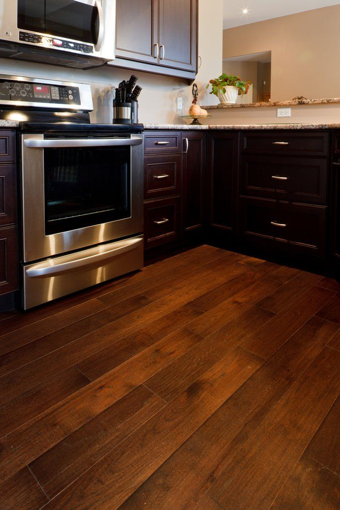 dark kitchen cabinets with a dark wood flooring in Hickory (With images) | Hickory kitchen ...