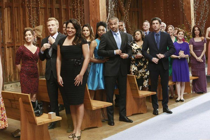 Pin for Later: The Ultimate Grey's Anatomy Wedding Photo Album  All the guests can't help but smile.