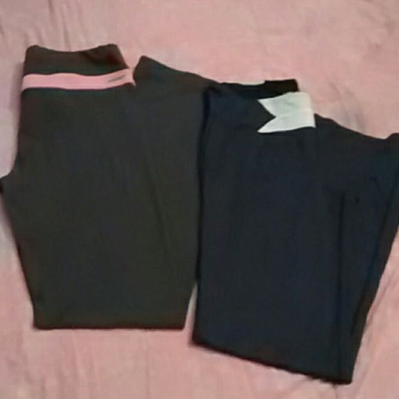 Victoria's Secret ~ VSX ~ workout / yoga pants (2) 1st pr are gray w pink waistband (doesn't fold dwn) 'VSX Sport, Sleek Fit, Regular Length' Excellent condition! No holes stains or piling at all, only worn a few times.Cotton/spandex blend. 2nd pr are Navy blue, w white band in front only  'VSX Flare Fit' Excellent, like new condition! No flaws whatsoever! Worn maybe 2-3 x at the most. Body is nylon/spandex blend and liner is a poly/spandex blend. Both pair have a small mesh pocket inside…