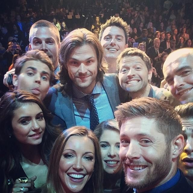 CW's version of the Oscar Selfie: I see 11 wonderful CW actors here including: Jensen Ackles, Jared Padalecki, and Misha Collins from Supernatural. Stephen Amell, John Barrowman, Colton Haynes, Katie Cassidy, Emily Bett Rickards, and Paul Blackthorne from Arrow. And Nina Dobrev and Paul Wesley from The Vampire Diaries. Love that they're all from CW's biggest shows!! Way to go CW family!