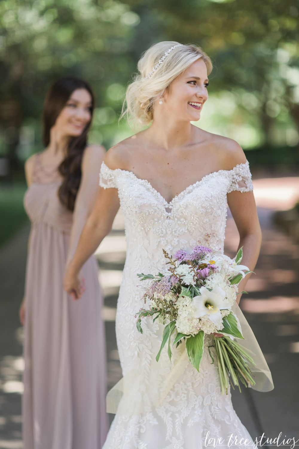 Stunning All over alencon lace bridal gown with fit and flare silhouette bateau neckline