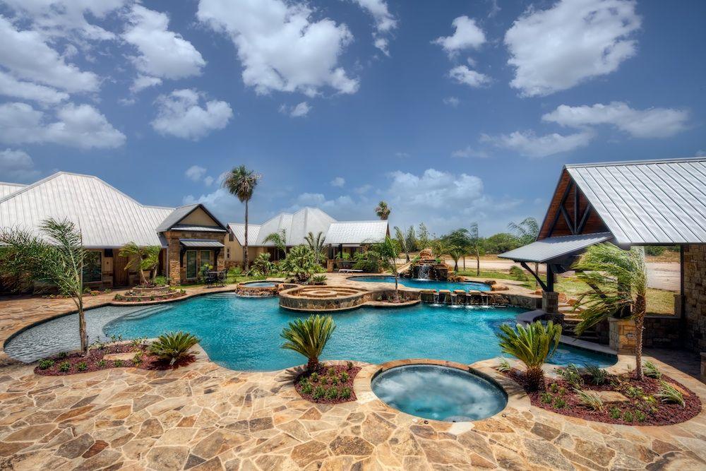 Custom Swimming Pool With Sunshelf Two Spas A Swim Up Bar Slide And Waterfall Free Form Pool Resort Style Pool Pool Beach Entry Pool Resort Style Pool