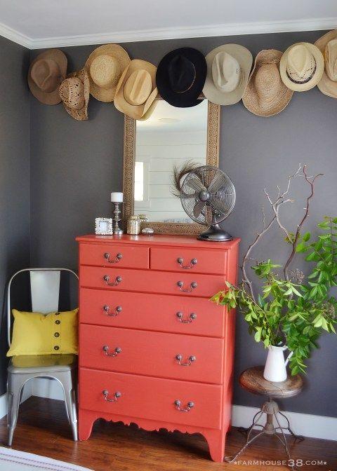 dark gray walls (Behr Ultra Trail Prints) + coral dresser (Farmhouse Red by Behr)