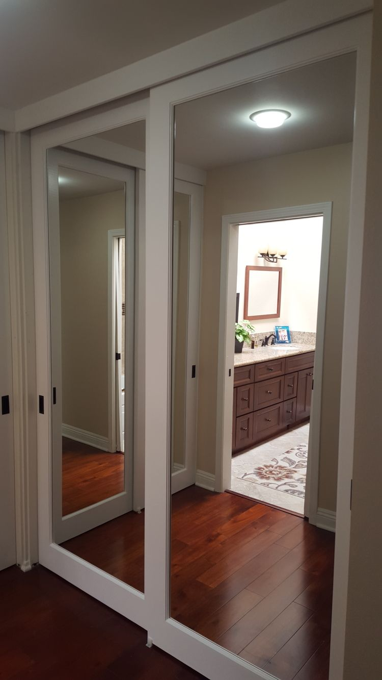 sliding bedroom closet door mirror Mirrored Closet Doors … | closet hacks | Mirro…