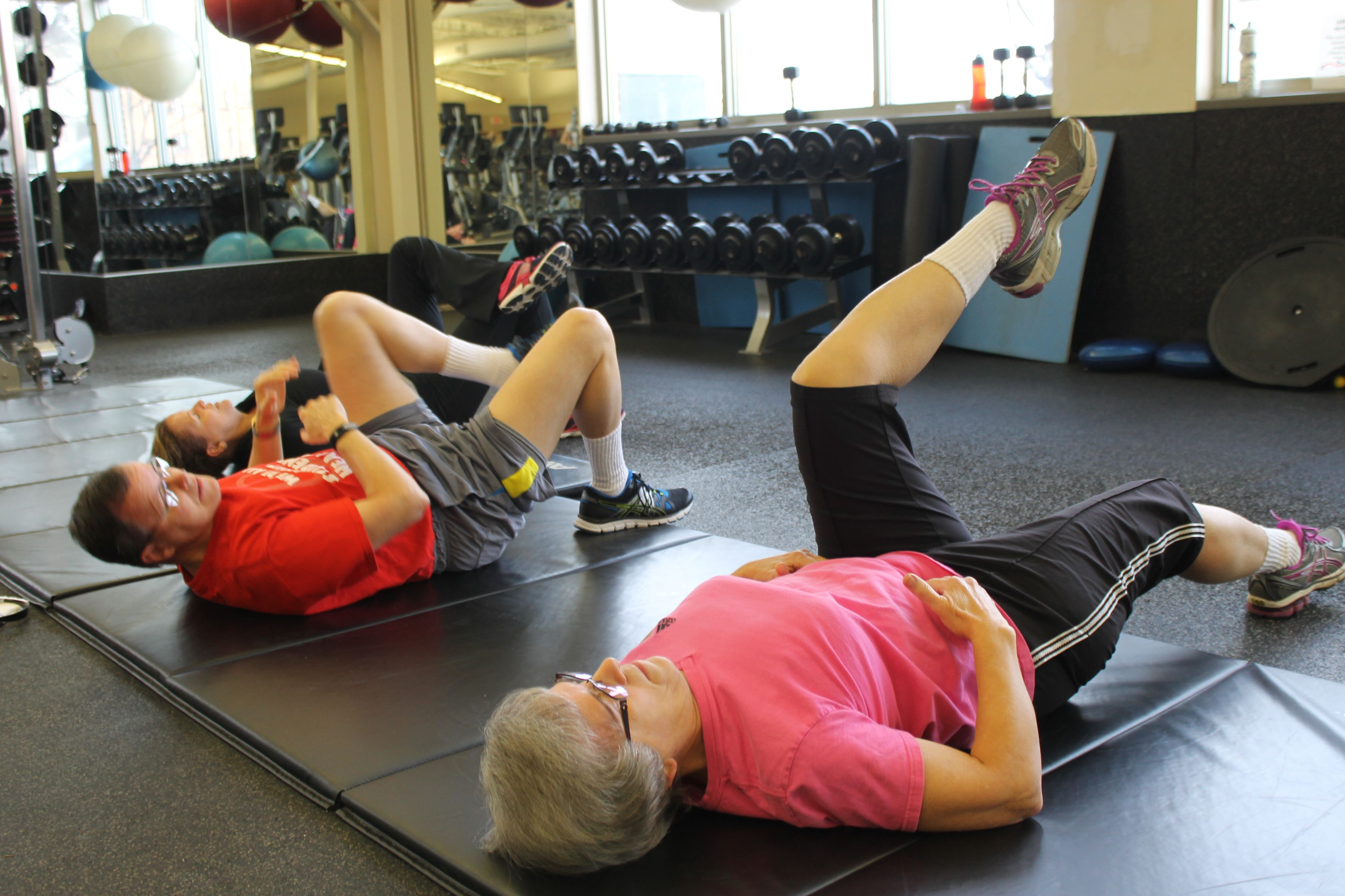 Gerry and Jane Kennedy stretch before exercising at the north Ames Racquet and Fitness Center on Wednesday Jan. 13, 2016. Photo by Grayson Schmidt/Ames Tribune  http://amestrib.com/news/resolution-23-years-and-counting