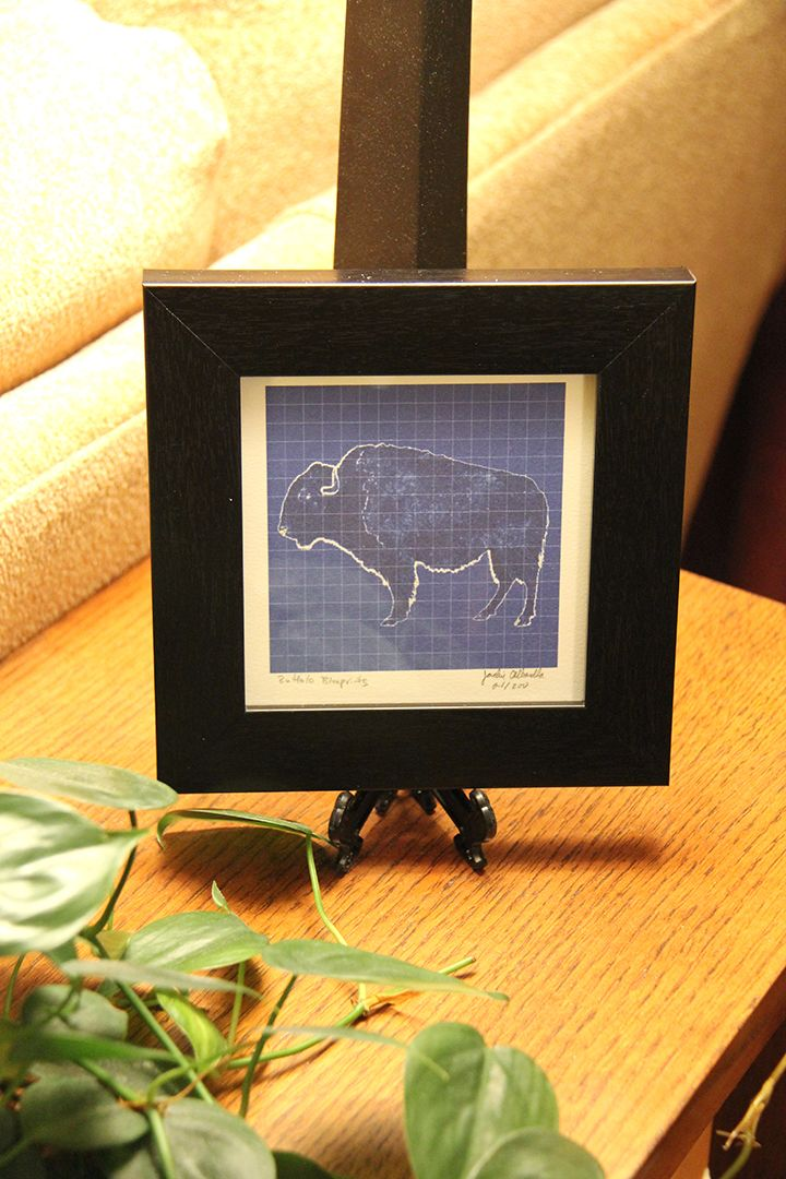 """The Buffalo: The symbol of """"The Queen City"""", home of great architecture, snowy winters and chicken wings.  The Buffalo Blueprints are a series of iconic images of #Buffalo featuring the architecture and culture of our beloved city. Framed and signed by the artist, they make great gifts.  These 5 x 5 Framed Prints are created on watercolor paper and are numbered and signed by the artist. Framed in a black matt frame, they come ready to hang."""