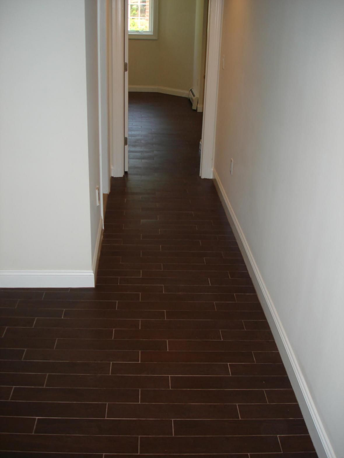 Wood tile floor set on thirds to mimmic a wood floor for Tiled hallway floor ideas