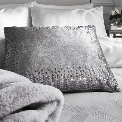 By Caprice A beautifully soft and luxurious velvet boudoir cushion with filling pad with cross-stitched detail and tassels to four corners
