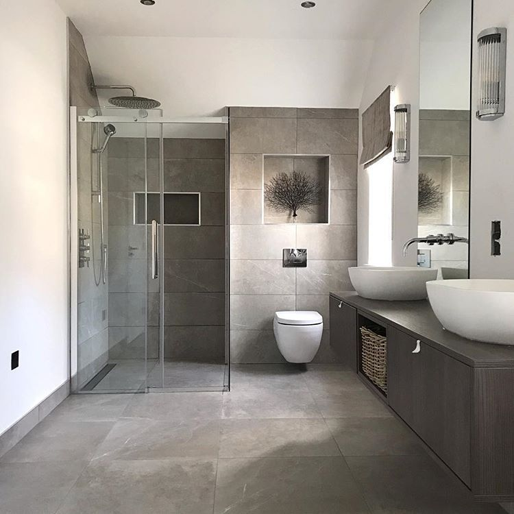 bathroom en suite neutral grey tiles double wall mounted