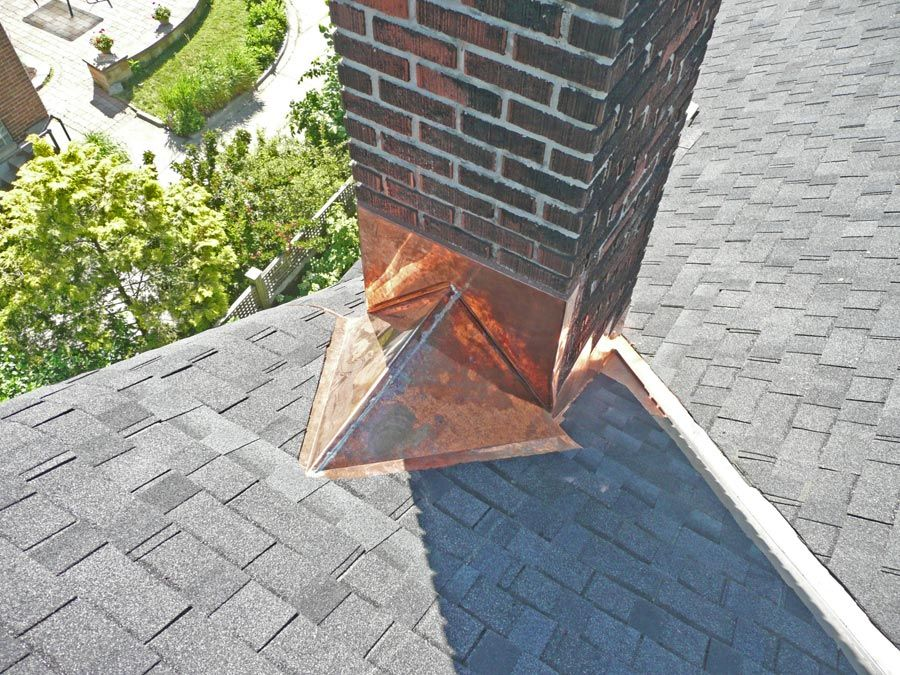 Copper Cricket And Step Flashing At Masonry Chimney On