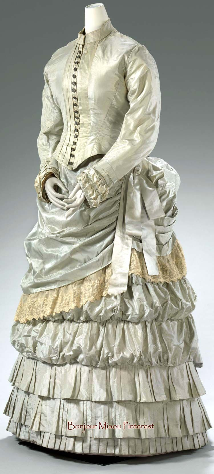 Day dress, English, ca. 1883. Two pieces. Pale green silk trimmed with cream lace. National Gallery of Victoria #englishdresses1880
