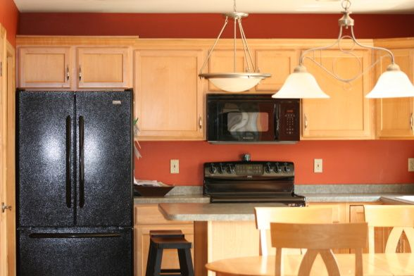 Orange kitchen walls...very similar to ours but we have white cabinets & appliances & our countertops are a darker gray with teal flecks in them.  I was inspired at the time but I wish I could do-over the countertops now.  Oh, well!  Too late...gotta find a way to love them again!