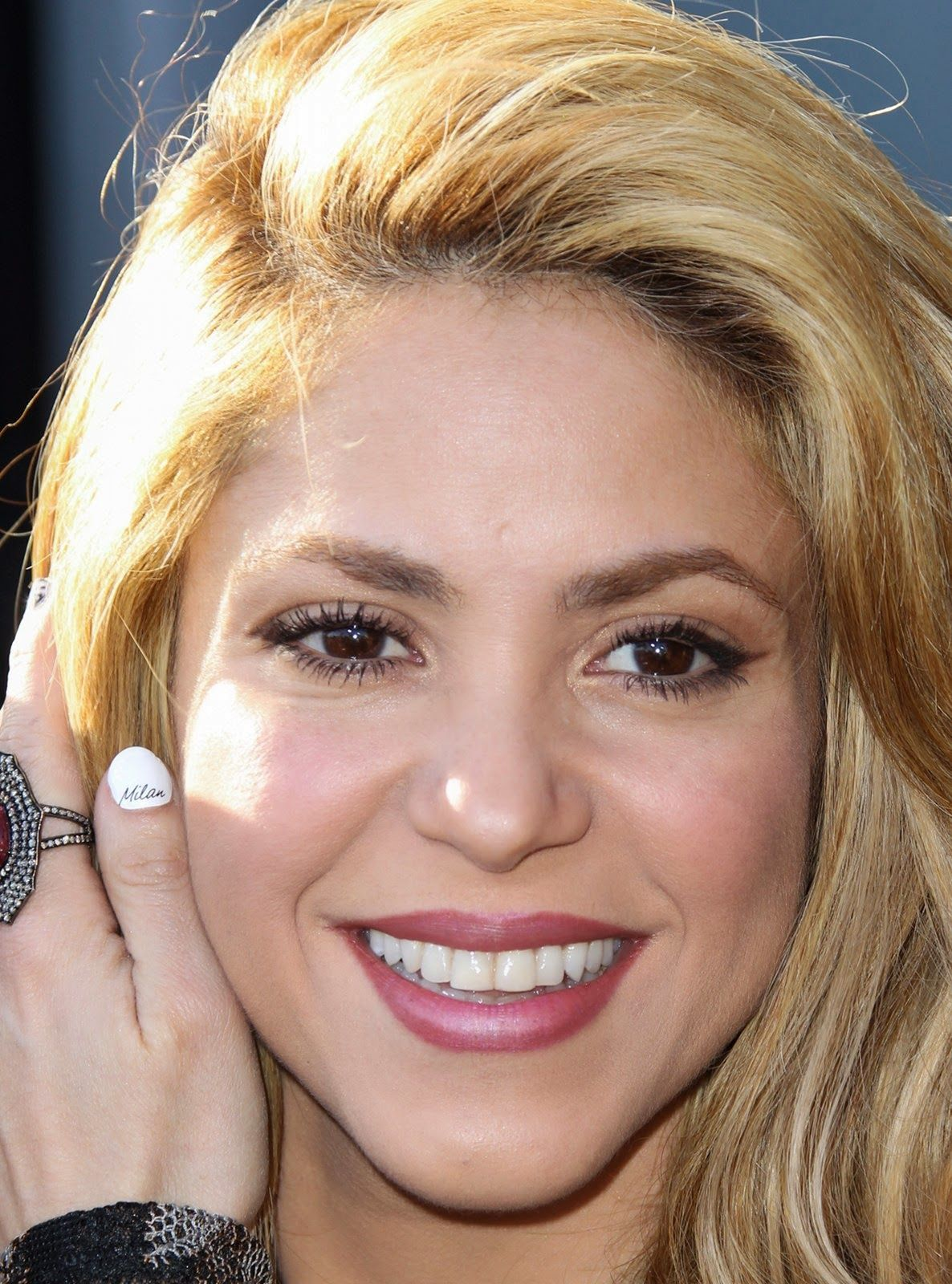 Shakira ... Look at her Finger :) it says Milan....how cute ...