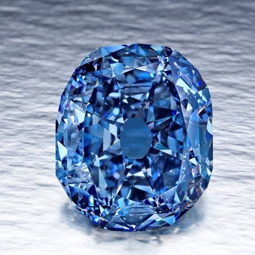 """The Wittelsbach Diamond started as a fancy deep grayish blue diamond weighing in at 35.56 carats. Origins unknown, the diamond """"appeared"""" in 1962 and was determined to be of Indian origin. Passing from one royal family to another, it was eventually sold at auction in 2008 for $23.4 million to London-based jeweler Laurence Graff. Graff then recut the stone, revising it to a Internal Flawless 31.06 carats Fancy Deep Blue Diamond. The biggest blue diamond in the world."""