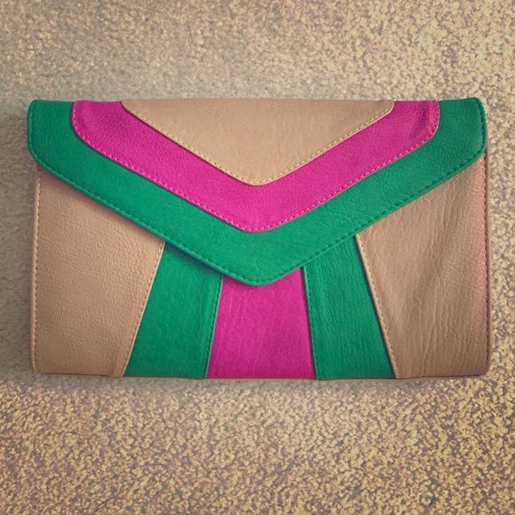 """NEW Nine West Clutch Bag NEW (without tags) Nine West Clutch bag with gold chain strap for shoulder or crossbody use.  Tan bag with green and pink accent and green inside lining.  Includes two multi-function and one zipper pockets inside.  Purse dimensions:  12"""" (w) x 7 3/4"""" (h) x 1/2"""" (deep) with 21 1/2"""" drop handle.  See matching green pumps in my closet to go with the clutch! Nine West Bags"""