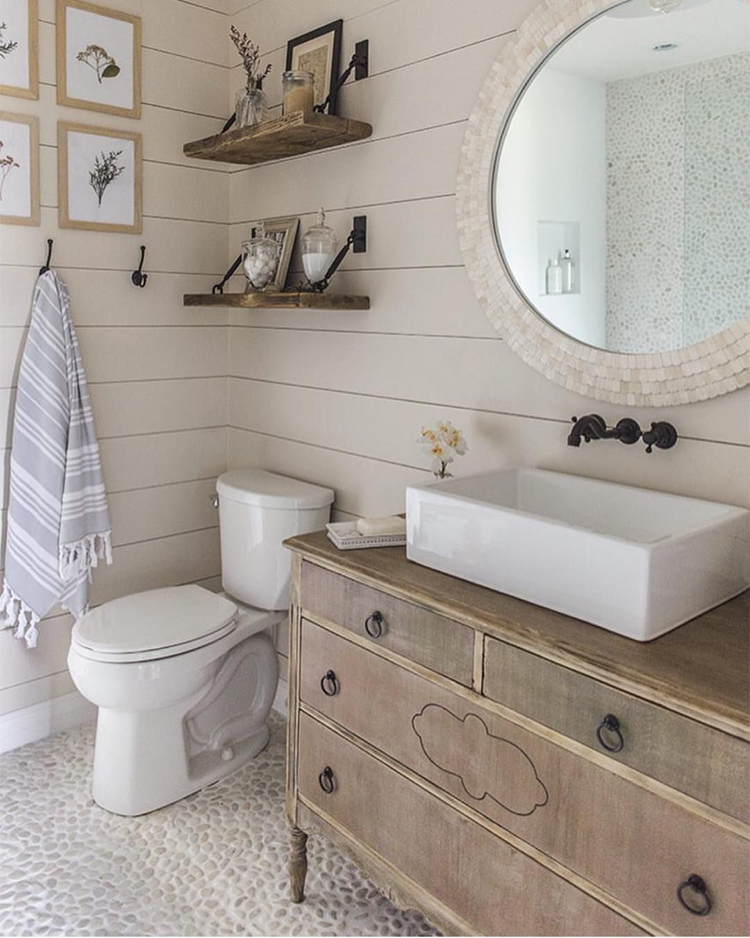 I've been loving shiplap walls in bathrooms for a while now. I didn