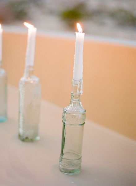 tall candles in glass bottles Style Me Pretty   Gallery