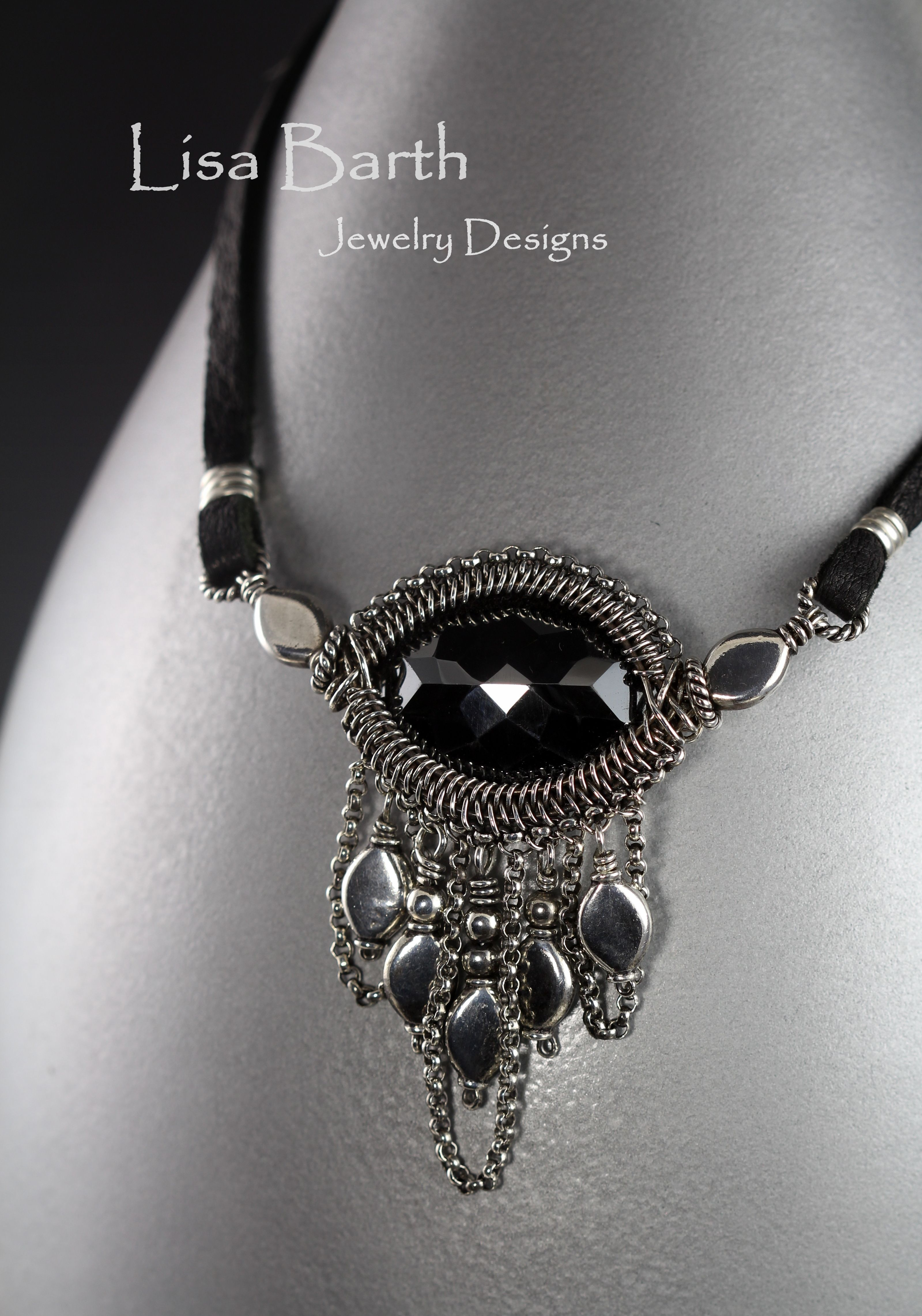 Hematite cab with a bit of wire work. I couldn\'t help but add a few ...