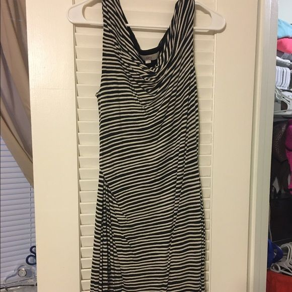 Ann Taylor LOFT knit dress Ann Taylor LOFT knit dress in black and off-white stripes. Stretchy and fully lined. Sleeveless and gently gathered on one side. Super-flattering, knee-length. Very good used condition. Smoke free home. LOFT Dresses