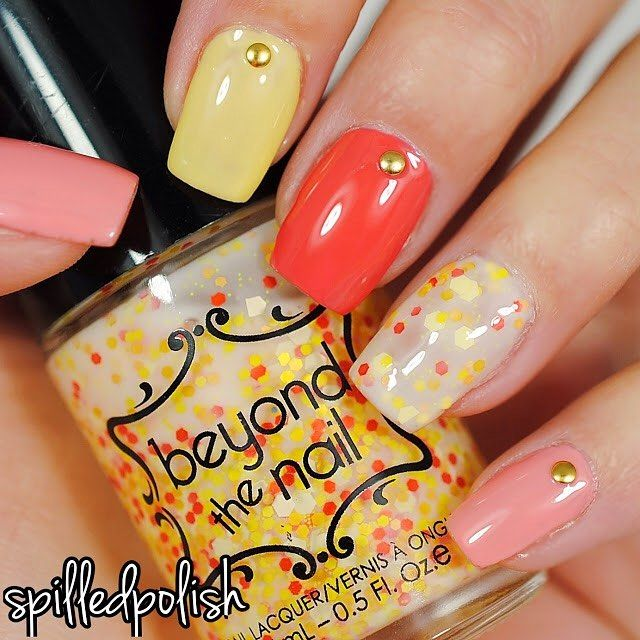 ✨Peachy Spring Nails✨  I used our SPRING YELLOW CREME, SPRING ORANGE CREME, COSMOPOLITAN, & PEACH BELLINI for this mani! ✌🏻️ Nail studs are from @bornprettystore.  Get these polishes online at: www.beyondthenail.com