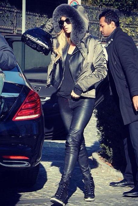 4820315d6c62 Paris Hilton wearing Yves Saint Laurent Patent Bow Bag in Black