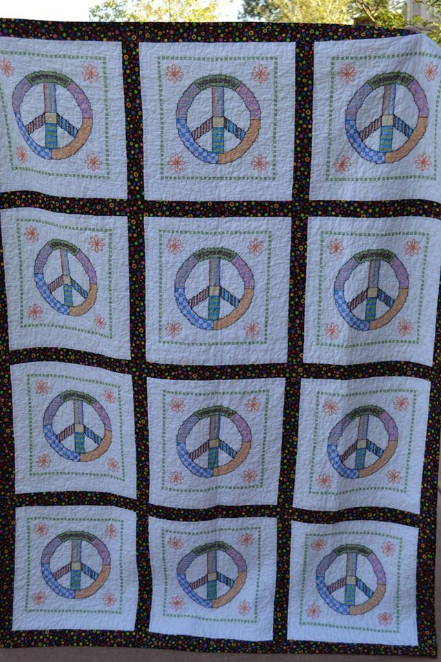 Peace sign cross stitched quilt by InnovativeCreate on Etsy