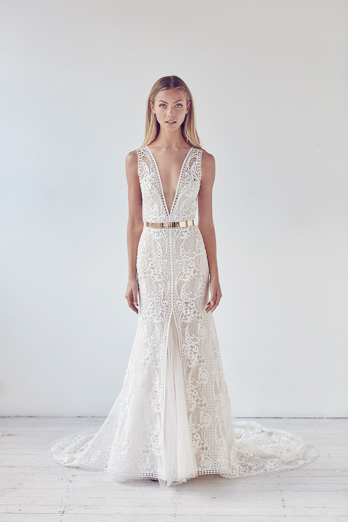 b6ff4022b3 Deep V-neck lace fit and flare wedding dress with slit .
