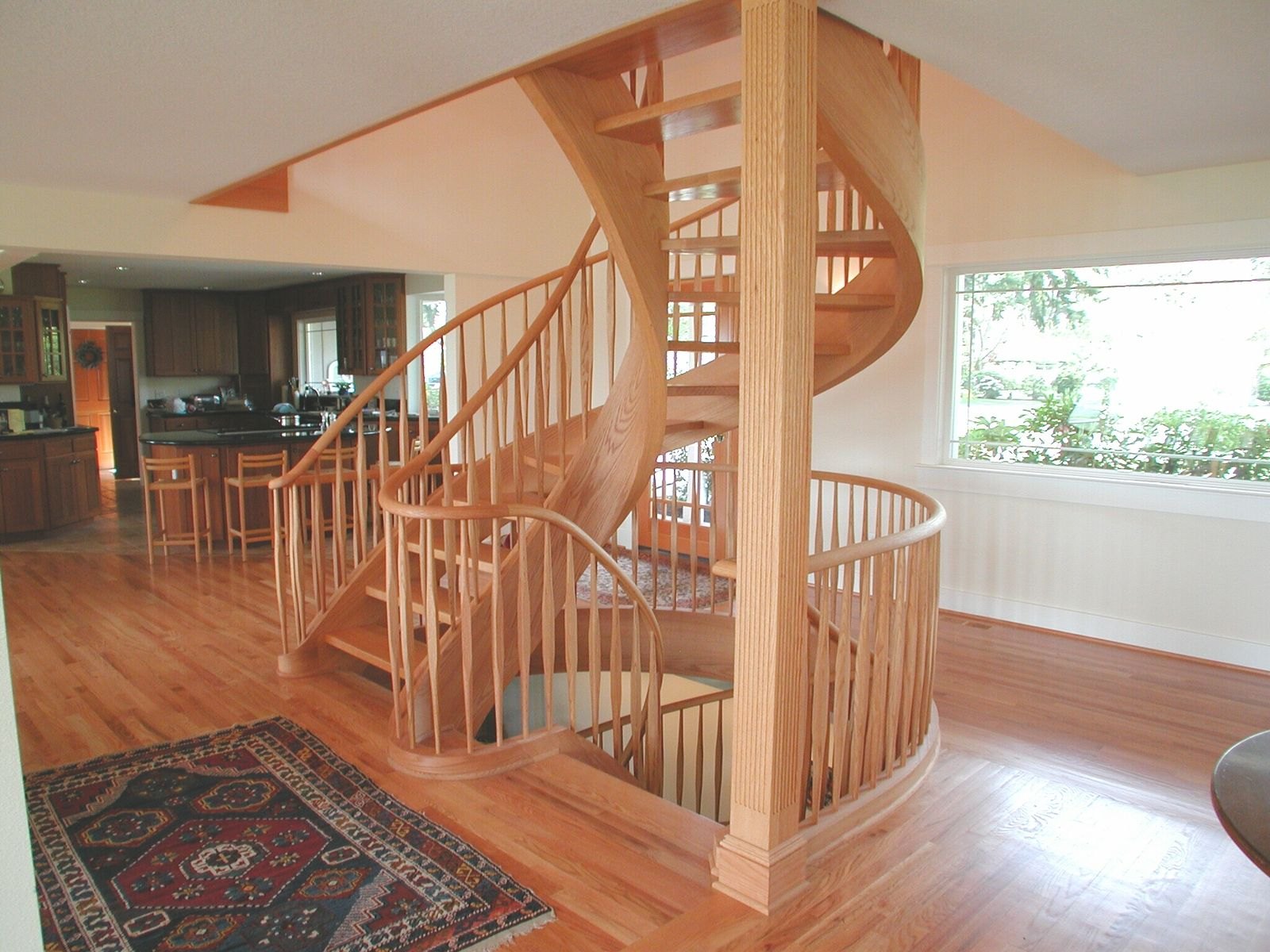 Graceful Red Oak Two Story Tight Spiral Stair