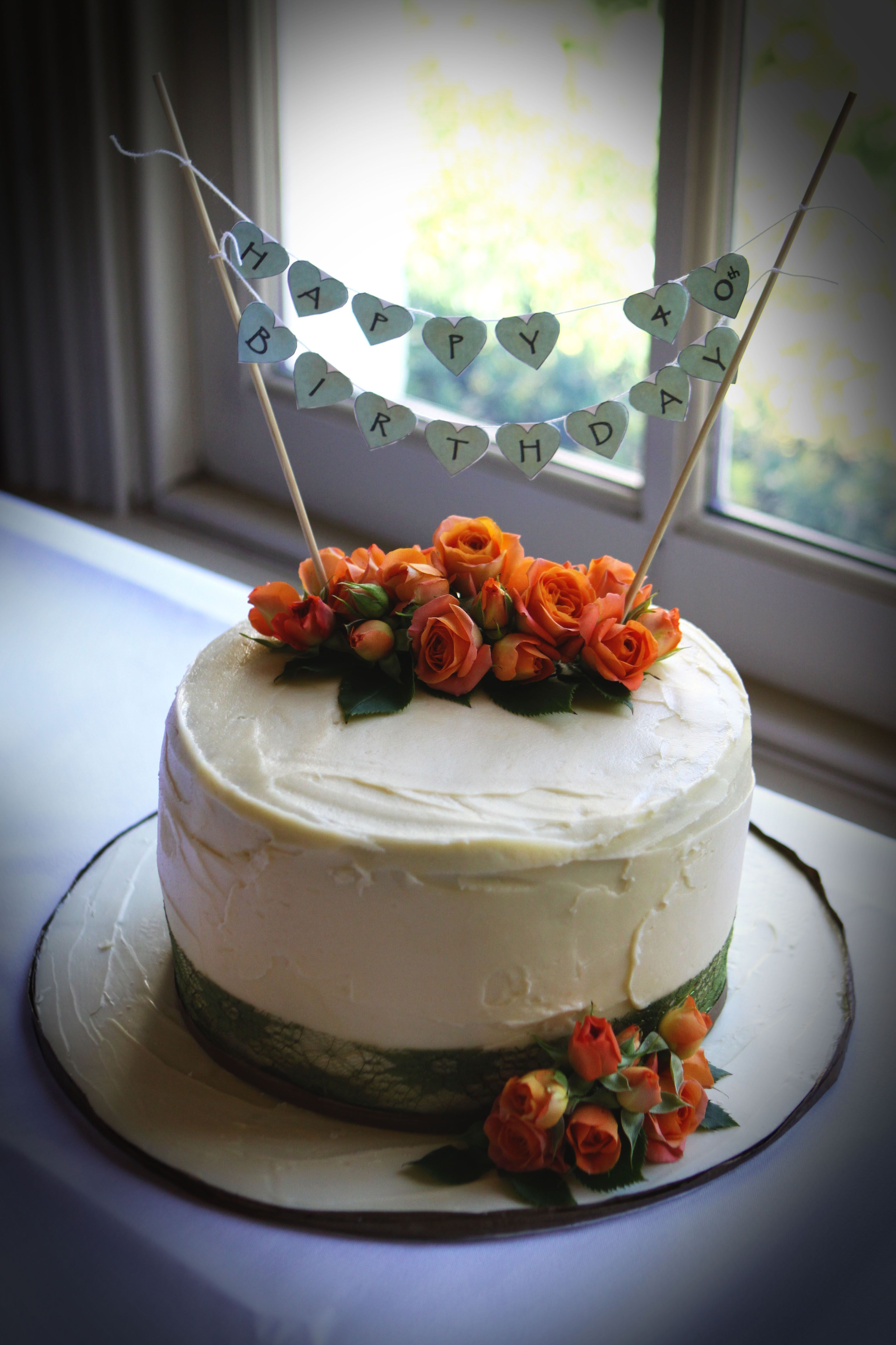 Hummingbird cake with cream cheese frosting decorated with fresh